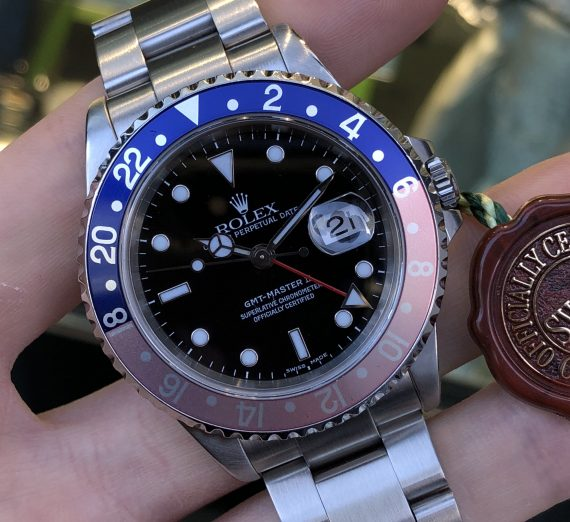 A vintage Rolex GMT with a Pepsi bezel in exceptional condition and complete 14