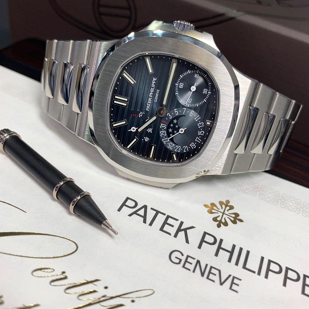 A Patek Philippe Nautilus Blue Dial Moonphase 5712 1a Carr Watches