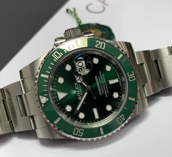 A Rolex Submariner green dial and bezel