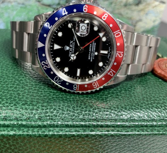 A vintage Rolex GMT with a Pepsi bezel in exceptional condition and complete 19
