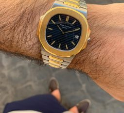 PATEK PHILIPPE NAUTILUS 18CT YELLOW GOLD AND STAINLESS STEEL