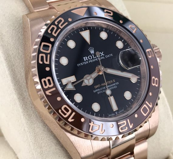 ROLEX 18CT ROSE GOLD GMT WITH BROWN AND BLACK BEZEL 12