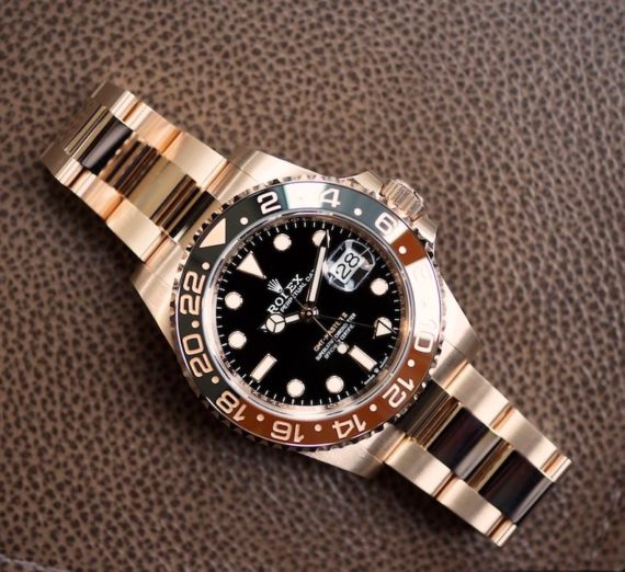ROLEX 18CT ROSE GOLD GMT WITH BROWN AND BLACK BEZEL 13