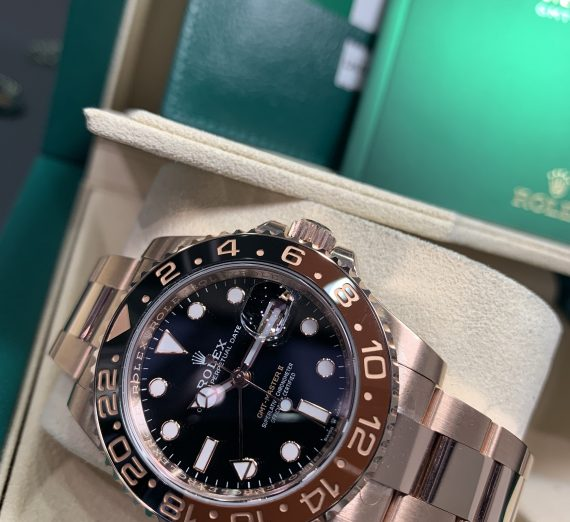 ROLEX 18CT ROSE GOLD GMT WITH BROWN AND BLACK BEZEL