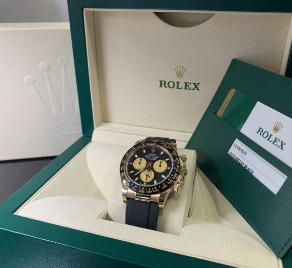 ROLEX COSMOGRAPH DAYTONA 18CT YELLOW GOLD BLACK AND CHAMPAGNE COLOUR DIAL 116518LN 28