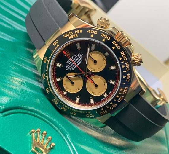 ROLEX COSMOGRAPH DAYTONA 18CT YELLOW GOLD BLACK AND CHAMPAGNE COLOUR DIAL 116518LN 30