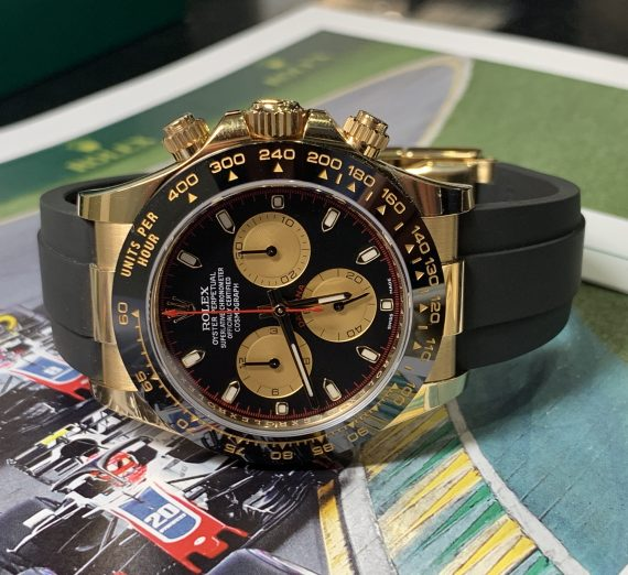 ROLEX COSMOGRAPH DAYTONA 18CT YELLOW GOLD BLACK AND CHAMPAGNE COLOUR DIAL 116518LN 33