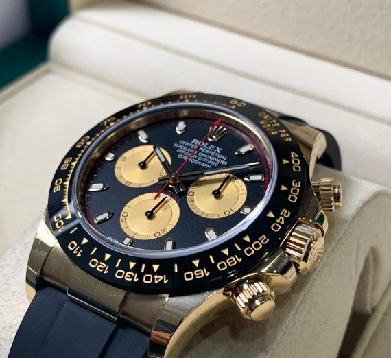 ROLEX COSMOGRAPH DAYTONA 18CT YELLOW GOLD BLACK AND CHAMPAGNE COLOUR DIAL 116518LN 37