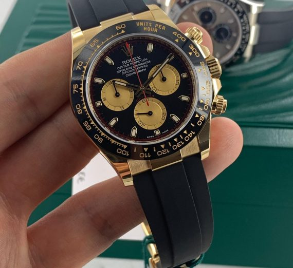 ROLEX COSMOGRAPH DAYTONA 18CT YELLOW GOLD BLACK AND CHAMPAGNE COLOUR DIAL 116518LN 40