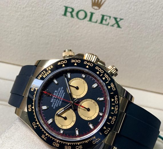 ROLEX COSMOGRAPH DAYTONA 18CT YELLOW GOLD BLACK AND CHAMPAGNE COLOUR DIAL 116518LN 41