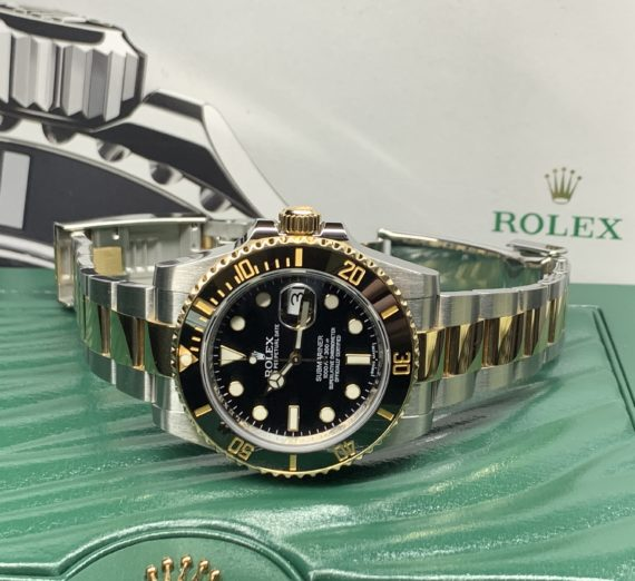 ROLEX SUBMARINER STAINLESS STEEL AND 18CT YELLOW GOLD 116613LN 4