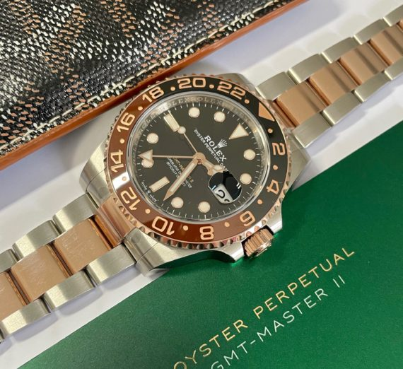 A 2021 ROLEX GMT MASTER  IN 18CT ROSE GOLD AND STEEL 9