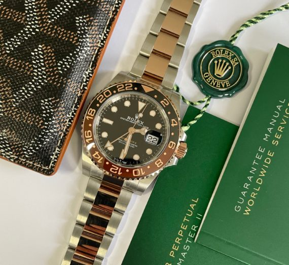A 2021 ROLEX GMT MASTER  IN 18CT ROSE GOLD AND STEEL 12