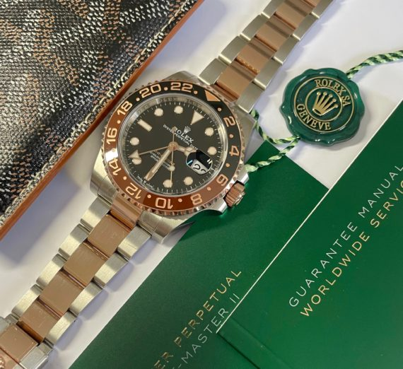 A 2021 ROLEX GMT MASTER  IN 18CT ROSE GOLD AND STEEL 13