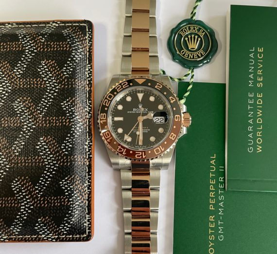 A 2021 ROLEX GMT MASTER  IN 18CT ROSE GOLD AND STEEL 14