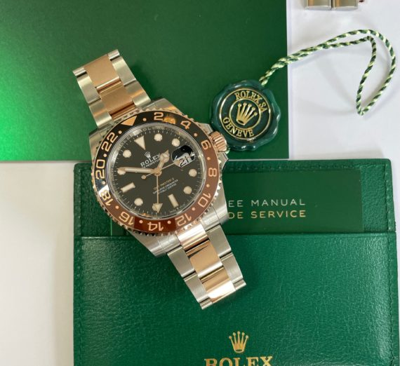 A 2021 ROLEX GMT MASTER  IN 18CT ROSE GOLD AND STEEL 1