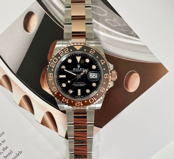 A 2021 ROLEX GMT MASTER  IN 18CT ROSE GOLD AND STEEL 5