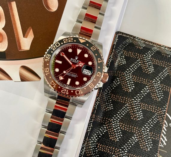 A 2021 ROLEX GMT MASTER  IN 18CT ROSE GOLD AND STEEL 6